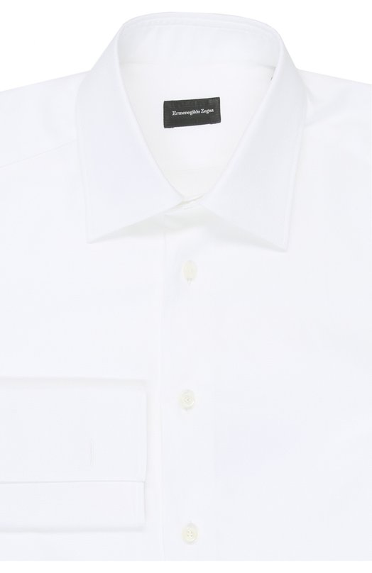 Сорочка Ermenegildo ZegnaРубашки<br>В классическую коллекцию бренда, основанного Эрменеджильдо Зенья, вошла белая сорочка с длинными рукавами, воротником кент и французскими манжетами. Модель прямого кроя сшита из легкого гладкого хлопка. Рекомендуем сочетать с серым костюмом, коричневыми брогами и асимметричными запонками.<br><br>Российский размер RU: 56<br>Пол: Мужской<br>Возраст: Взрослый<br>Размер производителя vendor: 44<br>Материал: Хлопок: 100%;<br>Цвет: Белый