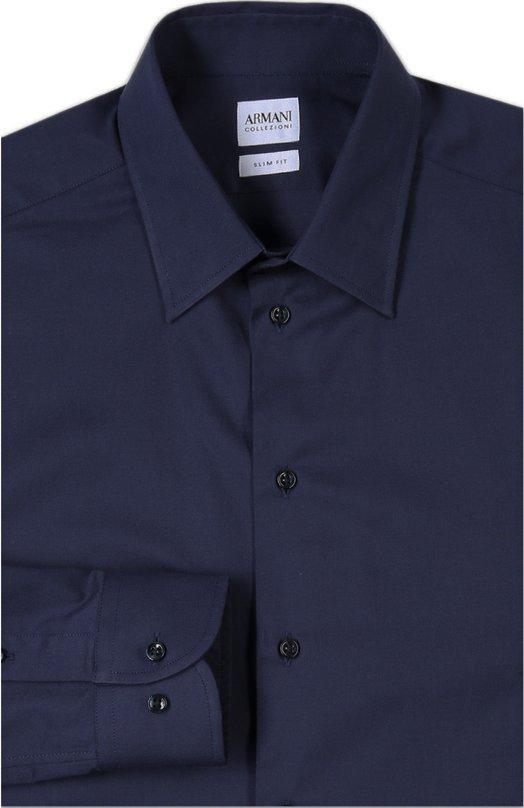 Сорочка Armani CollezioniРубашки<br>Приталенная сорочка с воротником кент и итальянскими манжетами вошла в осенне-зимнюю коллекцию бренда, основанного Джорджио Армани. Модель выполнена из эластичного хлопка темно-синего цвета. Наши стилисты советуют сочетать с черным костюмом, синим галстуком и двойными монками.<br><br>Российский размер RU: 44<br>Пол: Мужской<br>Возраст: Взрослый<br>Размер производителя vendor: 44<br>Материал: Хлопок: 98%; Эластан: 2%;<br>Цвет: Темно-синий