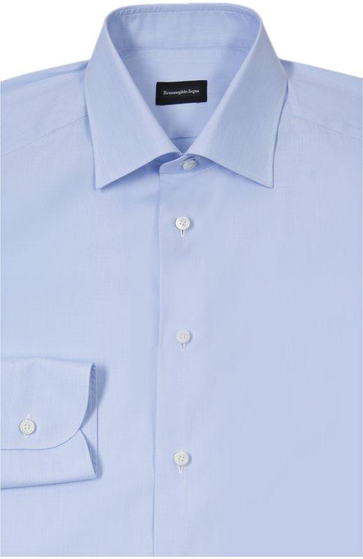 Рубашка Ermenegildo ZegnaРубашки<br>Мастера бренда, основанногоЭрменеджильдо Зенья,выполнили рубашку с длинным рукавом из мягкого хлопка синего цвета. Модель из коллекции сезона осень-зима 2015 года застегивается на пуговицы. Советуем сочетать с серым костюмом в тонкую полоску и черными дерби.<br><br>Российский размер RU: 52<br>Пол: Мужской<br>Возраст: Взрослый<br>Размер производителя vendor: XL<br>Материал: Хлопок: 100%;<br>Цвет: Синий