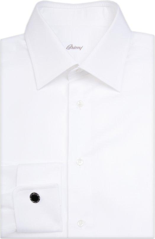 Сорочка BrioniРубашки<br>Элегантная белая сорочка с длинными рукавами и французскими манжетами вошла в осенне-зимнюю коллекцию 2015 года. Модель раскроена и сшита вручную мастерами бренда из тонкого шелковистого хлопка с едва заметным рисунком.<br><br>Российский размер RU: 46<br>Пол: Мужской<br>Возраст: Взрослый<br>Размер производителя vendor: 46<br>Материал: Хлопок: 100%;<br>Цвет: Белый
