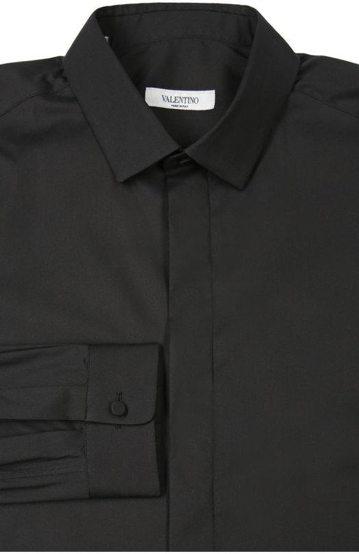 Сорочка ValentinoРубашки<br>Для создания рубашки дизайнеры бренда, основанного Валентино Гаравани, выбрали тонкий хлопок черного цвета. Модель вошла в коллекцию сезона весна-лето 2016 года. Изделие с воротником акула и длинными рукавами застегивается на потайные пуговицы.<br><br>Материал: Хлопок: 74%; Эластан: 3%; Полиамид: 23%;<br>Российский размер RU: 56<br>Размер производителя vendor: 44<br>Цвет: Черный<br>Пол: Мужской<br>Возраст: Взрослый
