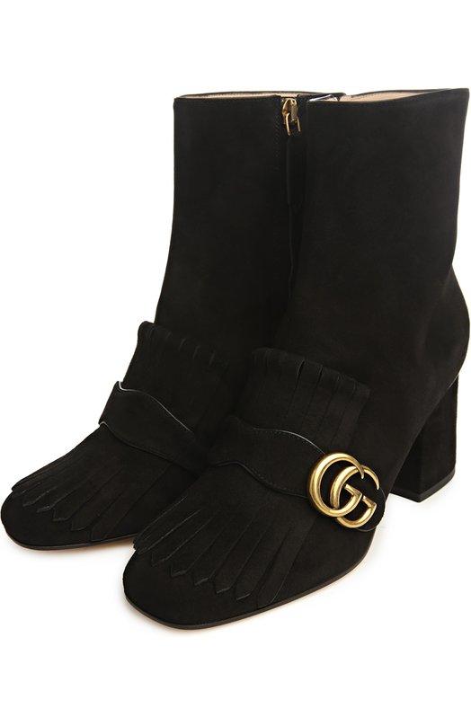 Полусапоги Marmont с пряжками GucciПолусапоги<br>Черные полусапоги на небольшом квадратном каблуке вошли в классическую коллекцию. Обувь из мягкой замши украшена бахромой и ремешком с архивной металлической пряжкой в виде инициалов Гучио Гуччи. Такая же украшала изделия бренда до середины 1990-х, когда одну из букв было решено развернуть.<br><br>Российский размер RU: 38<br>Пол: Женский<br>Возраст: Взрослый<br>Размер производителя vendor: 38-5<br>Материал: Стелька-кожа: 100%; Подошва-кожа: 100%; Замша натуральная: 100%;<br>Цвет: Черный