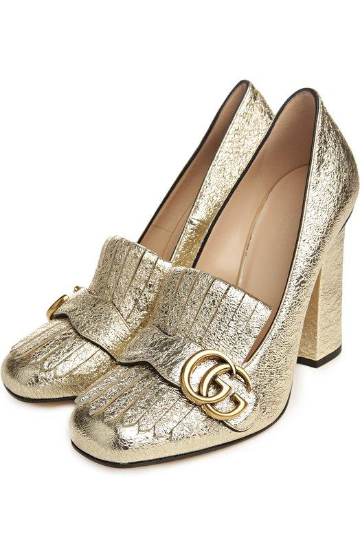 Кожаные туфли Marmont с пряжкой GucciТуфли<br>Туфли с круглым мысом, на высоком прямом каблуке сшиты из металлизированной мелкозернистой кожи золотого цвета. Союзка, как у лоферов, дополнена отворотом с короткой бахромой. для декора была выбрана архивная металлическая GG-монограмма, составленная из инициалов Гуччио Гуччи.<br><br>Российский размер RU: 39<br>Пол: Женский<br>Возраст: Взрослый<br>Размер производителя vendor: 39-5<br>Материал: Кожа натуральная: 100%; Стелька-кожа: 100%; Подошва-кожа: 100%;<br>Цвет: Золотой