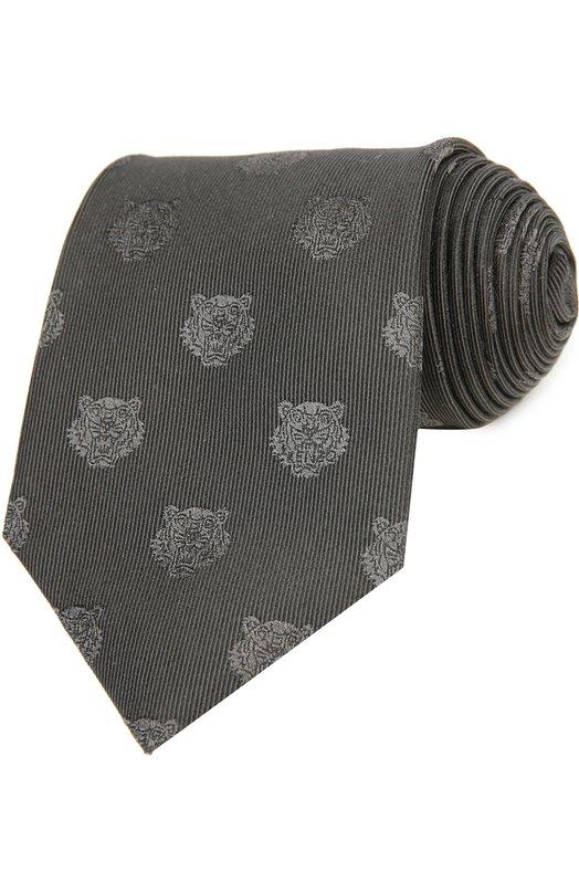 Галстук KenzoГалстуки<br>Черный галстук, украшенный мелкой вышивкой в виде анфаса льва, вошел в коллекцию сезона весна-лето 2016 года. Для изготовления аксессуара мастера марки, основанной Кензо Такада, использовали эластичный шелк жаккардового плетения. Наши стилисты рекомендуют носить с белой рубашкой и темным костюмом.<br><br>Пол: Мужской<br>Возраст: Взрослый<br>Размер производителя vendor: NS<br>Материал: Шелк: 100%;<br>Цвет: Черный