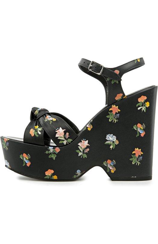 Кожаные босоножки Candy на танкетке Saint LaurentБосоножки<br>Черные босоножки Candy на танкетке вошли в весенне-летнюю коллекцию бренда, основанного Ивом Сен-Лораном. Модель из матовой гладкой кожи с ярким цветочным принтом декорирована узлом. Узкие ремешки, фиксирующие обувь на щиколотке, дополнены небольшими пряжками.<br><br>Российский размер RU: 36<br>Пол: Женский<br>Возраст: Взрослый<br>Размер производителя vendor: 36<br>Материал: Кожа натуральная: 100%; Стелька-кожа: 100%; Подошва-кожа: 100%;<br>Цвет: Черный