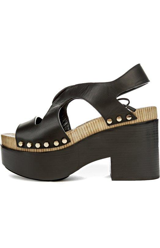 Босоножки BalenciagaБосоножки<br>Для производства обуви мастера марки, основанной Кристобалем Баленсиагой, использовали черную матовую кожу. Босоножки на массивной подошве и квадратном каблуке декорированы позолоченными заклепками. Модель из весенне-летней коллекции 2016 года плотно фиксируется на ноге с помощью тонкой шнуровки.<br><br>Российский размер RU: 40<br>Пол: Женский<br>Возраст: Взрослый<br>Размер производителя vendor: 40<br>Материал: Кожа натуральная: 100%; Стелька-кожа: 100%; Подошва-резина: 100%;<br>Цвет: Черный