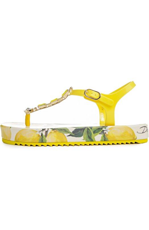 Сандалии Dolce &amp; GabbanaСандалии<br>Снадалии на платформе, обтянутой кожей с лимонным принтом, вошли в весенне-летнюю коллекцию бренда, основанного Доменико Дольче и Стефано Габбана. Узкие ремешки, фиксирующие обувь на ноге, выполнены из мягкого пластика. МОдель украшена желтыми и прозрачными кристаллами.<br><br>Российский размер RU: 40<br>Пол: Женский<br>Возраст: Взрослый<br>Размер производителя vendor: 40<br>Материал: Полиуретан: 90%; Стелька-резина: 100%; Подошва-резина: 100%; Кожа натуральная: 10%;<br>Цвет: Желтый
