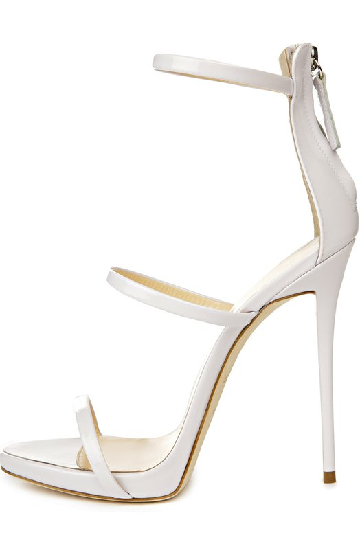 Лаковые босоножки Harmony Giuseppe Zanotti DesignБосоножки<br>Джузеппе Занотти включил в весенне-летнюю коллекцию 2016 года босоножки Harmony на высокой шпильке. Модель с тремя тонкими ремнями, фиксирующими обувь на ноге, и функциональной молнией на заднике выполнена из белоснежной лакированной кожи.<br><br>Российский размер RU: 37<br>Пол: Женский<br>Возраст: Взрослый<br>Размер производителя vendor: 37-5<br>Материал: Кожа натуральная: 100%; Стелька-кожа: 100%; Подошва-кожа: 100%;<br>Цвет: Белый