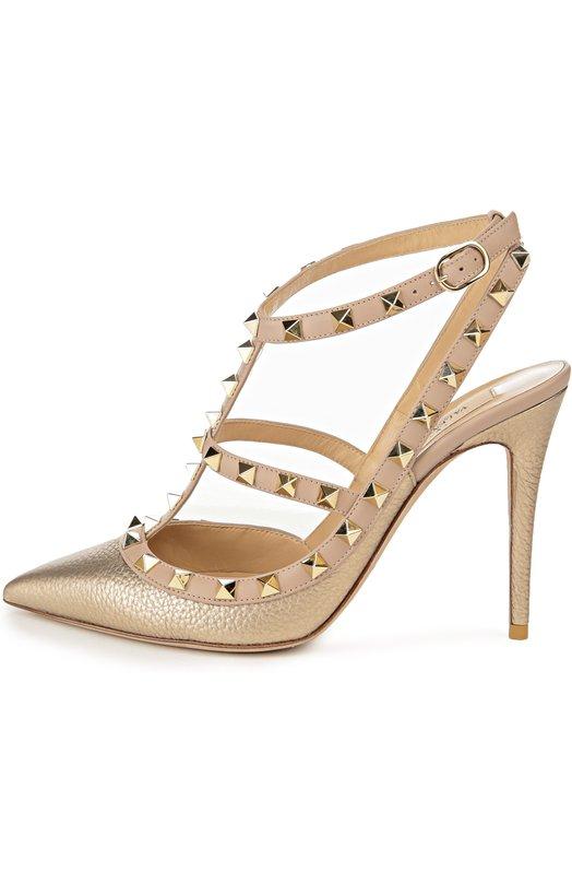 Кожаные туфли Rockstud на шпильке ValentinoТуфли<br>В весенне-летнюю коллекцию бренда, основанного Валентино Гаравани, вошли туфли с зауженным мысом, без задника. Обувь на высокой шпильке сшита из зерненой кожи золотого цвета. Кант и Т-образный ремешок декорированы шипами-пирамидами, ставшими знаковым декором для моделей линии Rockstud.<br><br>Российский размер RU: 37<br>Пол: Женский<br>Возраст: Взрослый<br>Размер производителя vendor: 37-5<br>Материал: Кожа натуральная: 100%; Стелька-кожа: 100%; Подошва-кожа: 100%;<br>Цвет: Золотой