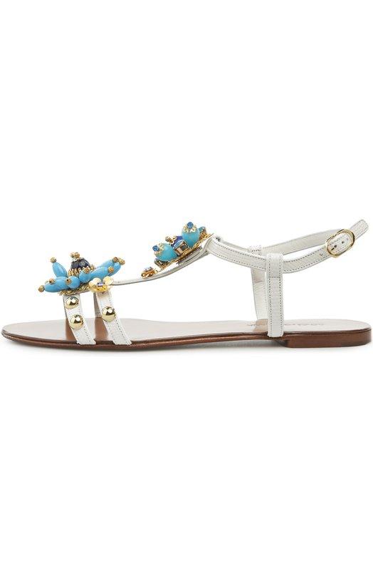 Кожаные сандалии с декором Dolce &amp; GabbanaСандалии<br>Модель на низком квадратном каблуке вошла в весенне-летнюю коллекцию марки, основанной Доменико Дольче и Стефано Габбана. Сандалии, сшитые из матовой зернистой кожи белого цвета, украшены бусинами и кристаллами голубого цвета. Обувь фиксируется на щиколотке тонким ремешком с пряжкой.<br><br>Российский размер RU: 38<br>Пол: Женский<br>Возраст: Взрослый<br>Размер производителя vendor: 38<br>Материал: Кожа натуральная: 100%; Стелька-кожа: 100%; Подошва-кожа: 100%;<br>Цвет: Белый