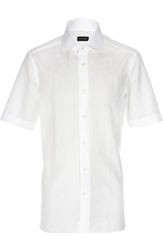 Сорочка Ermenegildo ZegnaРубашки<br>Мастера бренда, основанного Эрменеджильдо Зенья, использовали для создания белой рубашки с коротким рукавом мягкий хлопок с добавлением прочных льняных нитей. Модель с воротником кент вошла в коллекцию сезона весна-лето 2016 года. Нам нравится сочетать с клетчатой курткой, светлыми чиносами и кедами.<br><br>Российский размер RU: 50<br>Пол: Мужской<br>Возраст: Взрослый<br>Размер производителя vendor: 41<br>Материал: Хлопок: 65%; Лен: 35%;<br>Цвет: Белый
