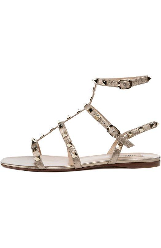 Кожаные сандалии Rockstud с ремешками ValentinoСандалии<br>Сандалии сшиты из мягкой металлизированной кожи. Модель из осенне-зимней коллекции 2016 года фиксируется на ноге ремнями с шипами-пирамидами, характерными для обуви бренда, основанного Валентино Гаравани.<br><br>Российский размер RU: 37<br>Пол: Женский<br>Возраст: Взрослый<br>Размер производителя vendor: 37<br>Материал: Кожа натуральная: 100%; Стелька-кожа: 100%; Подошва-кожа: 100%;<br>Цвет: Золотой