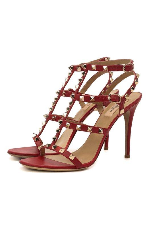 Кожаные босоножки Rockstud на шпильке ValentinoБосоножки<br>Модель Rockstud из осенне-зимней коллекции 2016 года декорирована металлическими шипами-пирамидами, характерными для обуви марки, основанной Валентино Гаравани. Босоножки сшиты из мягкой матовой кожи. Обувь фиксируется на стопе и щиколотке тонкими ремнями с пряжками.<br><br>Российский размер RU: 40<br>Пол: Женский<br>Возраст: Взрослый<br>Размер производителя vendor: 40-5<br>Материал: Кожа натуральная: 100%; Стелька-кожа: 100%; Подошва-кожа: 100%;<br>Цвет: Красный