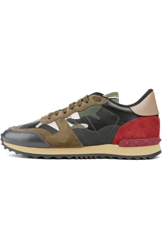 Комбинированные кроссовки Camouflage с принтом ValentinoКеды<br>Кожаные кроссовки с камуфляжным принтом вошли в осенне-зимнюю коллекцию 2016 года. Модель дополнена замшевыми вставками оливкового и красного цветов. Язычок украшен логотипом марки, основанной Валентино Гаравани. Задник декорирован знаковыми для обуви бренда пластиковыми шипами-пирамидами.<br><br>Российский размер RU: 38<br>Пол: Женский<br>Возраст: Взрослый<br>Размер производителя vendor: 38<br>Материал: Кожа натуральная: 100%; Подошва-резина: 100%; Замша натуральная: 100%; Стелька-текстиль: 100%; Отделка-текстиль: 100%;<br>Цвет: Разноцветный