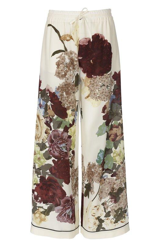 Шелковые брюки в пижамном стиле с цветочным принтом ValentinoБрюки<br>Брюки в пижамном стиле украшены разноцветным цветочным принтом Kimono, впервые использованное Валентино Гаравани в 1997 году. Модель с поясом-кулиской, сшитая из мягкого кремового крепдешина, вошла в осенне-зимнюю коллекцию 2016 года. Советуем сочетать с белой майкой и черными сандалиями.<br><br>Российский размер RU: 48<br>Пол: Женский<br>Возраст: Взрослый<br>Размер производителя vendor: L<br>Материал: Шелк: 100%;<br>Цвет: Кремовый