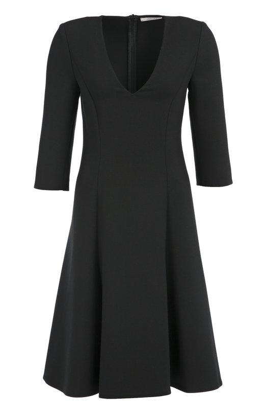 Приталенное платье с укороченным рукавом и V-образным вырезом Dorothee SchumacherПлатья<br>Доротея Шумахер выбрала для создания черной модели плотный эластичный текстиль. Короткое платье с расклешенным подолом вошло в коллекцию сезона осень-зима 2016 года. Изделие с глубоким V-образным вырезом и рукавами 3/4 застегивается сзади на потайную молнию.<br><br>Российский размер RU: 44<br>Пол: Женский<br>Возраст: Взрослый<br>Размер производителя vendor: 3<br>Материал: Полиэстер: 53%; Шерсть: 43%; Эластан: 4%;<br>Цвет: Черный