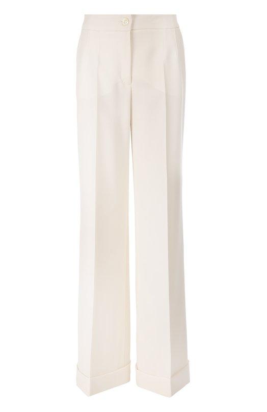 Широкие брюки с завышенной талией и стрелками Dolce &amp; GabbanaБрюки<br>Доменико Дольче и Стефано Габбана включили в осенне-зимнюю коллекцию 2016 года широкие белые брюки с завышенной линией талии, двумя боковыми карманами и стрелками. Модель с отворотами сшита из тонкой шерсти. Советуем носить с ярким топом, черными туфлями-лодочками и бежевой сумкой.<br><br>Российский размер RU: 44<br>Пол: Женский<br>Возраст: Взрослый<br>Размер производителя vendor: 42<br>Материал: Шерсть: 100%;<br>Цвет: Белый