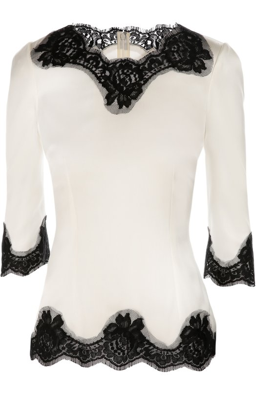 Шелковая приталенная блуза с кружевной отделкой Dolce &amp; GabbanaБлузы<br>Приталенная белая блуза из эластичного гладкого шелка вошла в осенне-зимнюю коллекцию 2016 года. Доменико Дольче и Стефано Габбана украсили модель с укороченными рукавами ажурным кордовым кружевом черного цвета. Нам нравится сочетать с брючным костюмом в тон, темными туфлями и бежевой сумкой.<br><br>Российский размер RU: 50<br>Пол: Женский<br>Возраст: Взрослый<br>Размер производителя vendor: 48<br>Материал: Шелк: 72%; Полиамид: 5%; Эластан: 3%; Хлопок: 20%;<br>Цвет: Белый