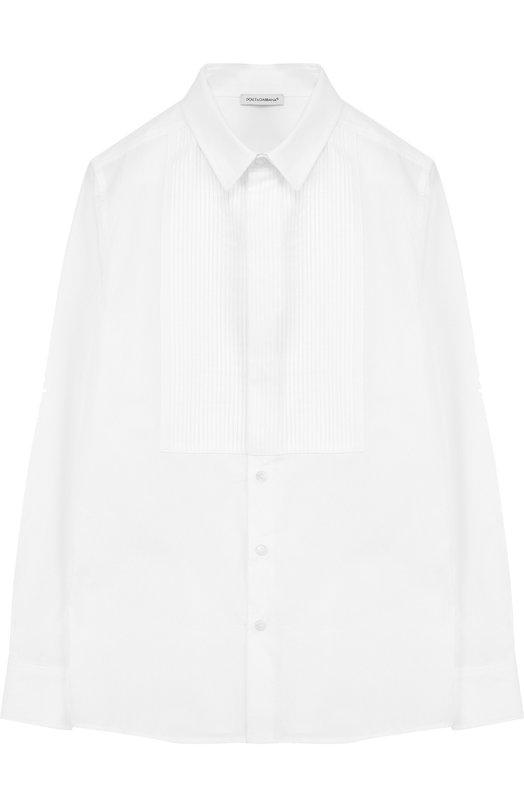 Хлопковая сорочка под смокинг Dolce &amp; GabbanaРубашки<br>Доменико Дольче и Стефано Габбана включили белую приталенную рубашку с длинными рукавами и плиссированной манишкой в коллекцию сезона осень-зима 2016 года. При создании модели мастера марки использовали тонкий белоснежный хлопок.<br><br>Размер Years: 12<br>Пол: Мужской<br>Возраст: Детский<br>Размер производителя vendor: 146-152cm<br>Материал: Хлопок: 100%;<br>Цвет: Белый