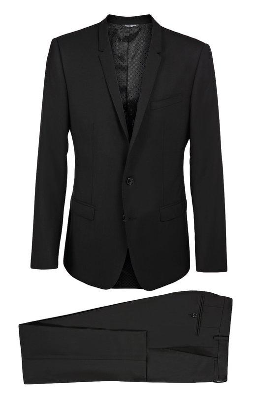 Шерстяной приталенный костюм Dolce &amp; GabbanaКостюмы<br>В коллекцию сезона осень-зима 2016 года вошел черный костюм из эластичной гладкой шерсти. Однобортный приталенный пиджак с узкими заостренными лацканами и карманами с клапанами дополнен брюками со стрелками. Нам нравится сочетать с голубой рубашкой, галстуком и платком-паше серого цвета.<br><br>Российский размер RU: 52<br>Пол: Мужской<br>Возраст: Взрослый<br>Размер производителя vendor: 50C<br>Материал: Шерсть: 97%; Подкладка-вискоза: 46%; Эластан: 3%; Подкладка-ацетат: 29%; Подкладка-купра: 25%;<br>Цвет: Черный