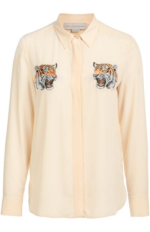 Шелковая удлиненная блуза с вышивкой в виде тигров Stella McCartneyБлузы<br>Стелла Маккартни включила в коллекцию сезона осень-зима 2016 года блузу Arlo с длинным рукавом и отложным воротником. Модель из кремового струящегося крепдешина украшена симметричной вышивкой в виде головы тигра. Наши стилисты советуют носить с черными ботильонами и юбкой с гепардовым рисунком.<br><br>Российский размер RU: 44<br>Пол: Женский<br>Возраст: Взрослый<br>Размер производителя vendor: 42<br>Материал: Шелк: 100%;<br>Цвет: Кремовый