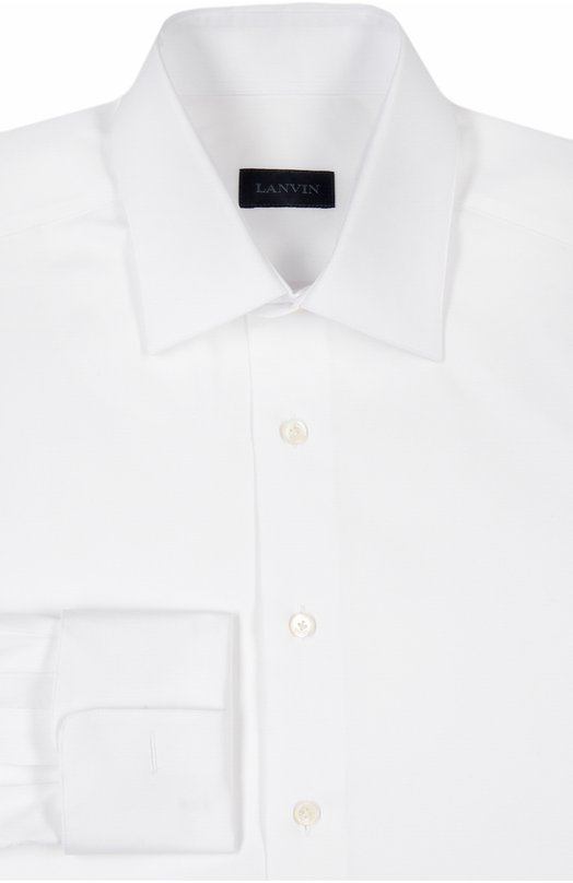 Хлопковая сорочка с манжетами под запонки LanvinРубашки<br>Для изготовления белой рубашки с длинными рукавами, дополненными французскими манжетами, мастера марки использовали мягкий хлопчатобумажный поплин. Модель с воротником кент вошла в осенне-зимнюю коллекцию 2016 года. Рекомендуем носить с темными костюмом, ярким галстуком и асимметричными запонками.<br><br>Российский размер RU: 54<br>Пол: Мужской<br>Возраст: Взрослый<br>Размер производителя vendor: 43<br>Материал: Хлопок: 100%;<br>Цвет: Белый