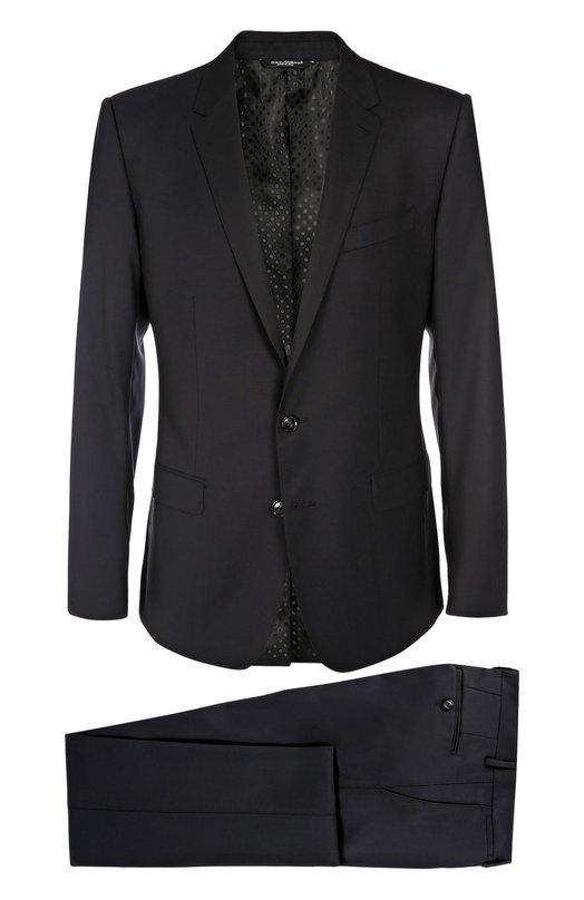 Шерстяной приталенный костюм Dolce &amp; GabbanaКостюмы<br>Доменико Дольче и Стефано Габбана включили темно-синий однобортный приталенный пиджак и брюки со стрелками в коллекцию сезона осень-зима 2016 года. Для создания костюма мастера бренда использовали мягкую шерсть стрейч. Советуем носить с черными рубашкой и дерби, а также с синим галстуком.<br><br>Российский размер RU: 58<br>Пол: Мужской<br>Возраст: Взрослый<br>Размер производителя vendor: 56R<br>Материал: Шерсть: 97%; Подкладка-вискоза: 46%; Эластан: 3%; Подкладка-ацетат: 29%; Подкладка-купра: 25%;<br>Цвет: Темно-синий
