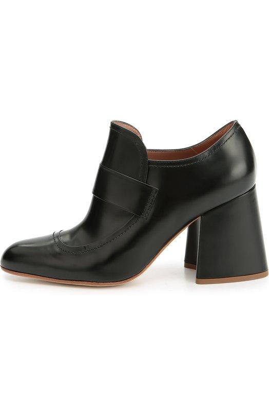 Кожаные ботильоны на фигурном каблуке MarniБотильоны<br>Закрытые туфли с зауженным мысом и на и устойчивом расклешенном каблуке, обтянутом кожей, вошли в осенне-зимнюю коллекцию 2016 года. При создании черной модели были использованы куски гладкой матовой кожи, сшитые видимыми седельными швами. Союзка дополнена широкой перемычкой, как у лоферов.<br><br>Российский размер RU: 37<br>Пол: Женский<br>Возраст: Взрослый<br>Размер производителя vendor: 37-5<br>Материал: Кожа натуральная: 100%; Стелька-кожа: 100%; Подошва-кожа: 100%;<br>Цвет: Черный