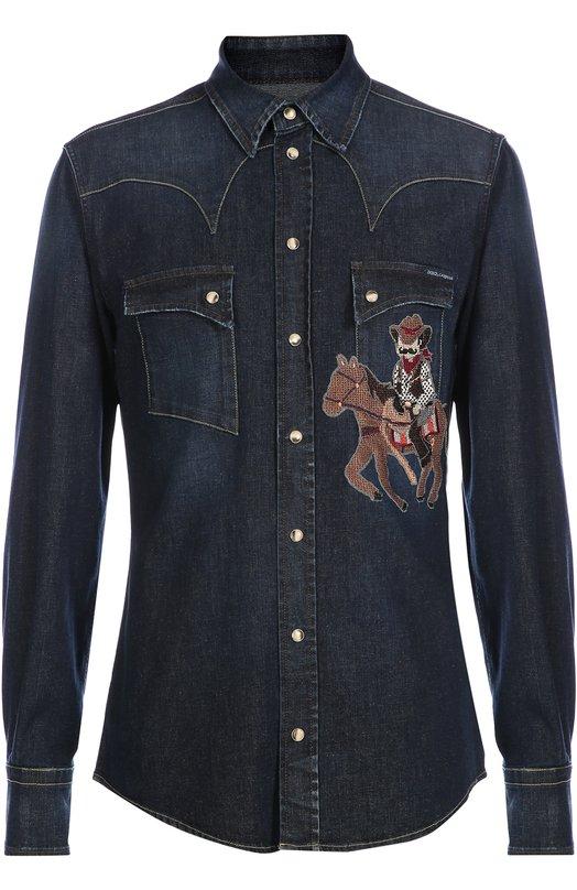 Джинсовая рубашка с вышивкой Dolce &amp; GabbanaРубашки<br>Приталенная рубашка с двумя нагрудными карманами украшена вышитой аппликацией DG Family в виде ковбоя, характерной для коллекции сезона осень-зима 2016 года. Доменико Дольче и Стефано Габбана выбрали для создания модели с длинными рукавами и отложным воротником эластичный синий деним.<br><br>Российский размер RU: 43<br>Пол: Мужской<br>Возраст: Взрослый<br>Размер производителя vendor: 43<br>Материал: Хлопок: 98%; Эластан: 2%; Отделка-вискоза: 100%;<br>Цвет: Синий