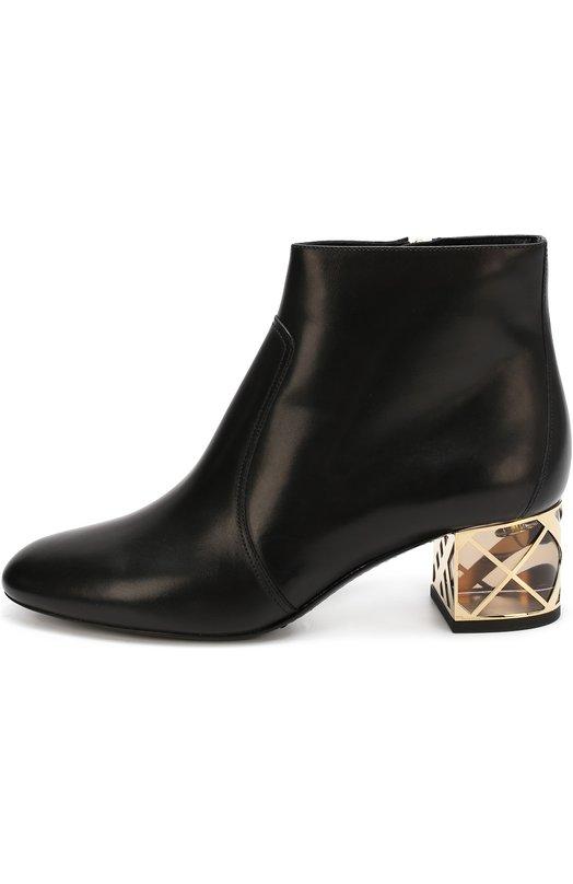 Кожаные ботильоны на декорированном каблуке BurberryБотильоны<br>Ботильоны, которые застегиваются на боковую молнию, сшиты из гладкой матовой кожи черного цвета. Устойчивый прозрачный каблук украшен металлической отделкой в виде решетки. Обувь с миндалевидным мысом вошла в осенне-зимнюю коллекцию марки, основанной Томасом Берберри.<br><br>Российский размер RU: 36<br>Пол: Женский<br>Возраст: Взрослый<br>Размер производителя vendor: 36-5<br>Материал: Кожа натуральная: 100%; Стелька-кожа: 100%; Подошва-кожа: 100%; Подошва-резина: 100%;<br>Цвет: Черный