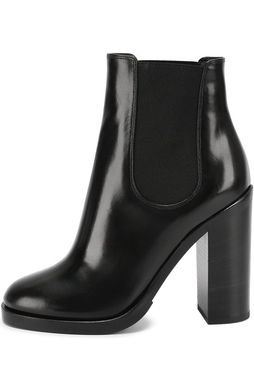 Кожаные ботильоны Lawrence на устойчивом каблуке Dolce &amp; GabbanaБотильоны<br>Доменико Дольче и Стефано Габбана выбрали для создания черных ботильонов гладкую мягкую кожу с глянцевым блеском. Модель Lawrence на широкой подошве и высоком устойчивом каблуке вошла в коллекцию сезона осень-зима 2016 года. Обувь дополнена эластичными боковыми вставками, как у челси.<br><br>Российский размер RU: 38<br>Пол: Женский<br>Возраст: Взрослый<br>Размер производителя vendor: 38-5<br>Материал: Эластан: 9%; Кожа натуральная: 71%; Полиэстер: 20%; Стелька-кожа: 100%; Подошва-резина: 100%;<br>Цвет: Черный