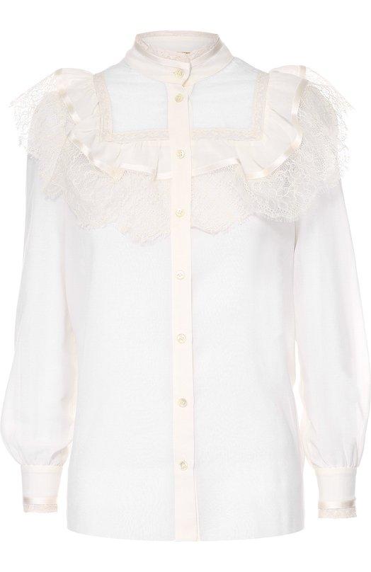 Блуза с кружевной отделкой и воротником-стойкой Saint LaurentБлузы<br>Эди Слиман включил в осенне-зимнюю коллекцию марки, основанной Ивом Сен-Лораном, блузу из гладкого хлопка цвета слоновой кости. Верх дополнен прозрачной сетчатой вставкой, края которой украшены тесьмой и кружевными воланами. Модель с воротником-стойкой и манжеты застегиваются на пуговицы.<br><br>Российский размер RU: 46<br>Пол: Женский<br>Возраст: Взрослый<br>Размер производителя vendor: 40<br>Материал: Хлопок: 84%; Шелк: 16%;<br>Цвет: Белый
