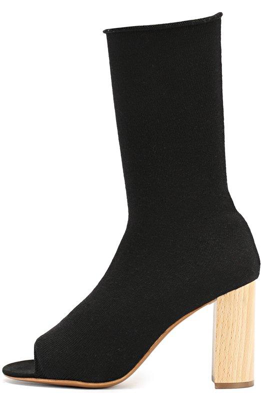 Текстильные ботильоны с открытым мысом Ports 1961Ботильоны<br>Ботильоны с открытым мысом, на высоком устойчивом деревянном каблуке вошли в коллекцию сезона осень-зима 2016 года. Для создания модели с облегающим голенищем мастера марки использовали эластичный черный трикотаж, поэтому обувь без застежки легко надевать и снимать.<br><br>Российский размер RU: 36<br>Пол: Женский<br>Возраст: Взрослый<br>Размер производителя vendor: 36<br>Материал: Стелька-кожа: 100%; Подошва-кожа: 100%; Текстиль: 100%;<br>Цвет: Черный