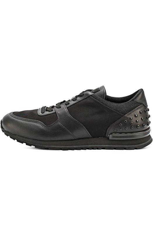 Кожаные кроссовки с текстильными вставками и фактурной отделкой Tod'sКеды<br>&amp;bull; Москва 376 EUR (26 300 RUB)&amp;bull; Милан 420 EUR&amp;bull; Лондон 417 EUR (375 GBP)&amp;bull; Дубай 501 EUR (2 030 AED)Мастера бренда сшили черные кроссовки из комбинации гладкой матовой кожи и прочного, хорошо пропускающего воздух материала. Модель на широкой подошве, дополненной противоскользящим протектором, вошла в коллекцию сезона осень-зима 2016 года. Задник украшен круглыми резиновыми шипами.<br><br>Российский размер RU: 41<br>Пол: Мужской<br>Возраст: Взрослый<br>Размер производителя vendor: 7-5<br>Материал: Кожа натуральная: 100%; Стелька-кожа: 100%; Подошва-резина: 100%; Текстиль: 100%;<br>Цвет: Черный