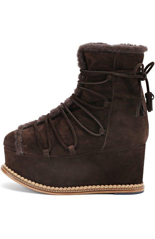 Замшевые полусапоги с меховой отделкой на платформе Paloma BarceloПолусапоги<br>Коричневые полусапоги на высокой платформе вошли в осенне-зимнюю коллекцию бренда, основанного Маноло Барсело. Утепленная мягким мехом модель сшита из прочной замши. Обувь с боковой молнией дополнена продетыми в широкие петли шнурками, длины которых хватит, чтобы дважды обернуть вокруг щиколотки.<br><br>Российский размер RU: 39<br>Пол: Женский<br>Возраст: Взрослый<br>Размер производителя vendor: 39<br>Материал: Стелька-кожа: 100%; Подошва-кожа: 100%; Подошва-резина: 100%; Замша натуральная: 100%; Отделка мех./овчина/: 100%;<br>Цвет: Коричневый