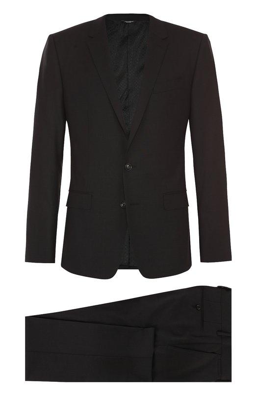 Шерстяной приталенный костюм Dolce &amp; GabbanaКостюмы<br>Доменико Дольче и Стефано Габбана включили темно-серый костюм в коллекцию сезона осень-зима 2016 года. Для его создания мастера марки использовали мягкую эластичную шерсть. Приталенный однобортный пиджак с узкими лацканами и тремя карманами дополнен зауженными брюками со стрелками.<br><br>Российский размер RU: 48<br>Пол: Мужской<br>Возраст: Взрослый<br>Размер производителя vendor: 48-R<br>Материал: Шерсть: 97%; Подкладка-вискоза: 46%; Эластан: 3%; Подкладка-ацетат: 29%; Подкладка-купра: 25%;<br>Цвет: Темно-серый